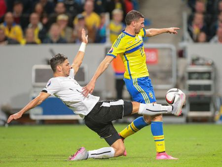camaraderie: STOCKHOLM, SWEDEN - SEPTEMBER 8, 2015: Aleksandar Dragovic (Austria) and Marcus Berg (Sweden) fight for the ball in an European Championship qualification game. Editorial