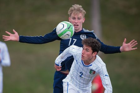 uefa: LINDABRUNN, AUSTRIA - MARCH 28, 2015: Oliver McBurnie (#17 Scotland) and Davide Calabria (#2 Italy) fight for the ball during an UEFA U19 qualifying game.