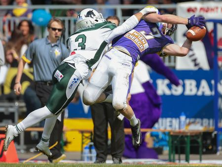 cb: VIENNA, AUSTRIA - MAY 17, 2015: CB Nathaniel Morris (#3 Unicorns) tackles WR Dominik Bundschuh (#3 Vikings) in a game of the Big Six Football League.