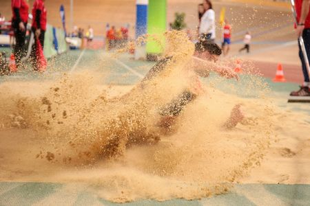 competes: VIENNA, AUSTRIA - JANUARY 31, 2015: Alper Kulaksiz (#280 Turkey) competes in the mens long jump event during an indoor track and field event. Editorial