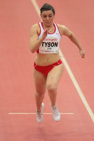 field event: LINZ, AUSTRIA - FEBRUARY 6, 2015: Abbi Tyson (#319 Great Britain) competes in the womens 60m event in an indoor track and field event. Editorial