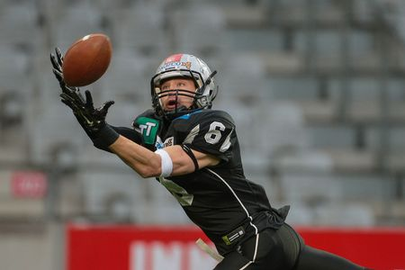 kyle: INNSBRUCK, AUSTRIA - MAY 2, 2015: WR Kyle Callahan (#6 Raiders) catches the ball in a game of the Big SIx Football League.