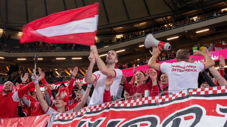 austria flag: STOCKHOLM, SWEDEN - SEPTEMBER 8, 2015: Austrian fans celebrate the victory after an European Championship qualification game.