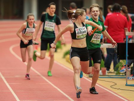 LINZ, AUSTRIA - FEBRUARY 6, 2015: Runners compete in the 4x200m mixed relay event in an indoor track and field event.