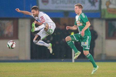 VIENNA, AUSTRIA - FEBRUARY 28, 2015: Michael Madl (#15 Sturm Graz) and  Robert Beric (#9 Rapid) fight for the ball in an Austrian football league game.