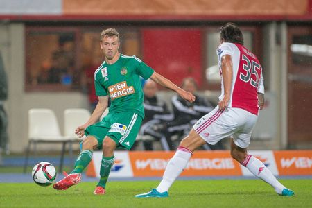 ajax: VIENNA, AUSTRIA - JULY 29, 2015: Philipp Schobesberger (SK Rapid) and Mitchell Dijks (Ajax) fight for the ball in an UEFA Champions League qualification game. Editorial
