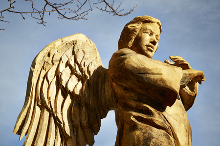 Giant carved wooden angel outdoor 版權商用圖片