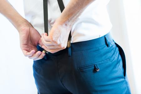 Man wearing suspender, selective focus.