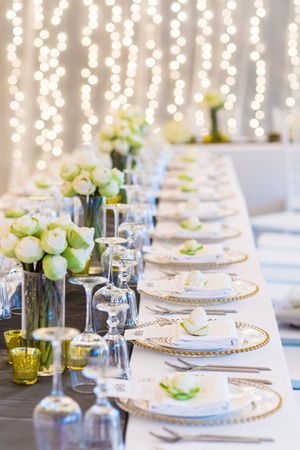 banquet table: Elegance table set up with lotus flowers, selective focus.