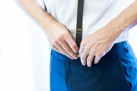 suspenders: Man wearing suspenders, selective focus.