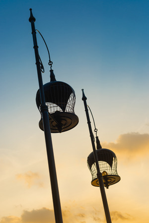 two tone: Two tone colors of sky with silhouette bird cages decoration.