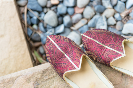 maroon leather: Traditional Indian shoes. Stock Photo