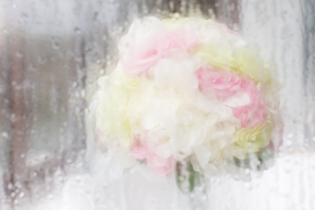 background waterfalls: Soft focus bouquet of roses behind water droplet mirror. Stock Photo
