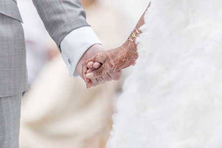 bride bangle: Close-up Holding Hands in indian wedding ritual. Stock Photo