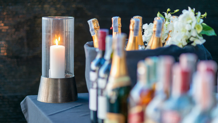 candle light: A candle light on brass stand in party. Stock Photo