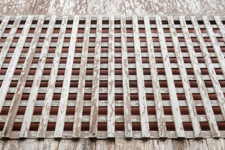 grate: Wooden grate window of old style thai house. Stock Photo