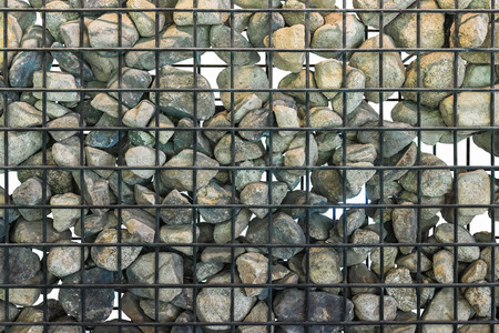 gabion mesh: Gabion in close up, Black cage filled with rocks. Isolated.