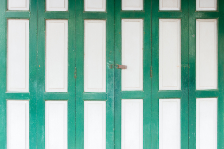 foreclosed: The old grunge folding door closed. Stock Photo