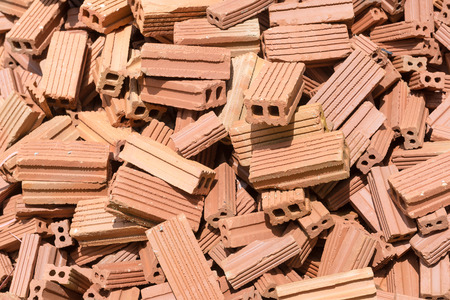 disengage: New bricks mound ready for construction. Stock Photo