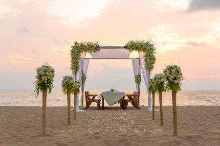 romantic beach: Romantic dinner setting on the beach at sunset.