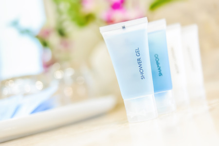 Toiletries tube in a luxury hotel, shower gel, shampoo, hair conditioner, body lotion.