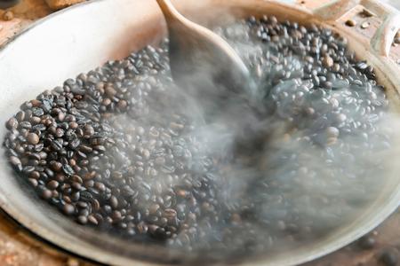 roasting: Traditional roasting coffee beans in pan.