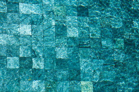 colorful water surface: colorful water surface with sun reflections. Ideal swimming pool, sea and ocean texture. Stock Photo