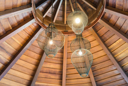 Ceiling lamps for interior decoration with wooden circle roof. Stock Photo