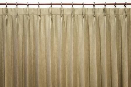 Brown curtains hang on the curtain rail.