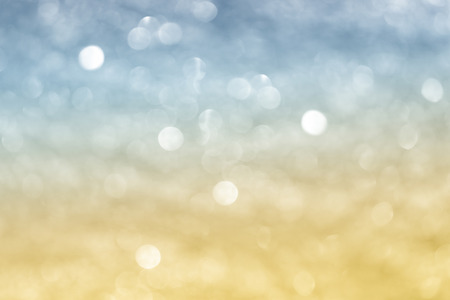 abstract festival background with defocused lights. bio colors light blue-yellow.