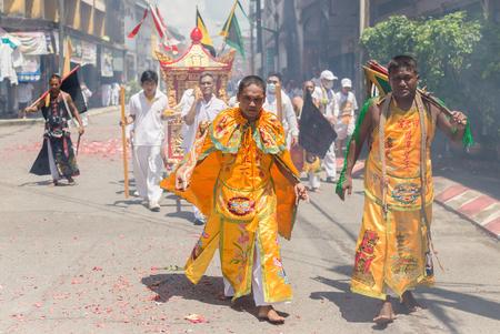 PHANG-NGA (TA-KUA-PA), THAILAND - SEPTEMBER 29: An unidentified people parade celebrate in Phang-Nga Vegetarian Festival on September 29, 2014 around the street of Phang-Nga province, Thailand.