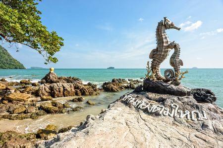 Chumphon, Thailand - December 31, 2014: Seahorse Statue and Golden Jar Statue on seashore - Landmark at newly famous traditional home stay village Baan Tong Tom Yai, Chumphon Province, Thailand.