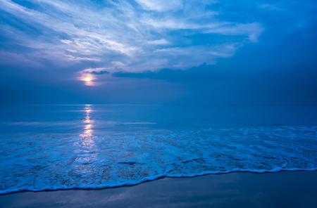 Beautiful secluded beach and smooth foam wave at night, Copy space.