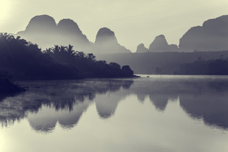Beautiful sunrise and reflections at natural lagoon, Nongtalay lagoon in Krabi Province, Thailand. Black & White.
