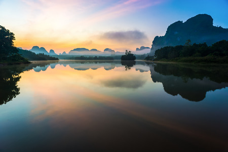 Beautiful sunrise and reflections at natural lagoon, Nongtalay lagoon in Krabi Province, Thailand.