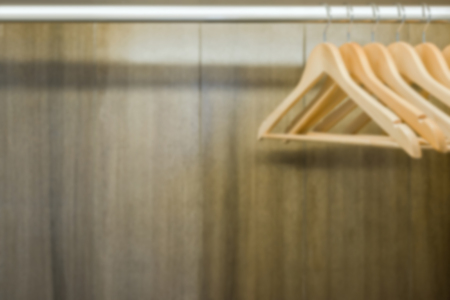 Blurry clothes hanger in wardrobe. Copy space.