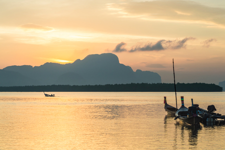 Longtail fishing boat at Samchong-Tai fishing village on sunrise in Phang-Nga, Thailand.