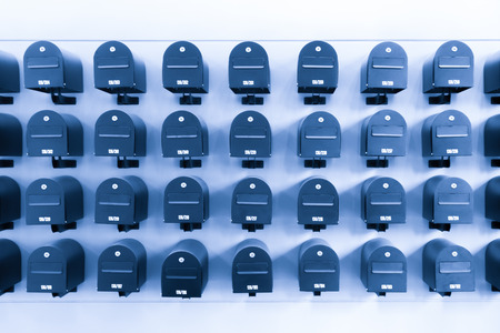 Mailboxes in residential for informations and news with room number, toned in blue. Standard-Bild