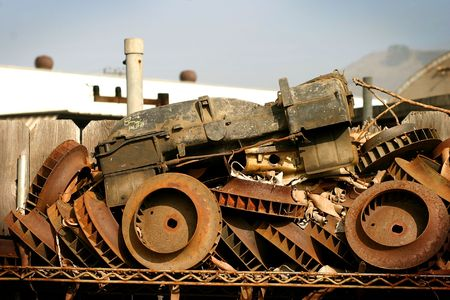 Some junk in a junk yard when viewing from the right angle builds an old tractor.  Stock Photo - 2457953