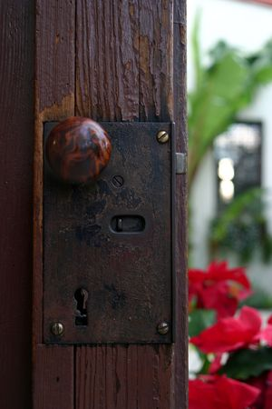 A doorknob a the mission San Bueanaventura in Ventura California Stock Photo - 2479672
