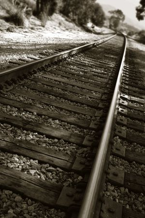wood railroads: railroad tracks shown in a different perspective in black and white Stock Photo