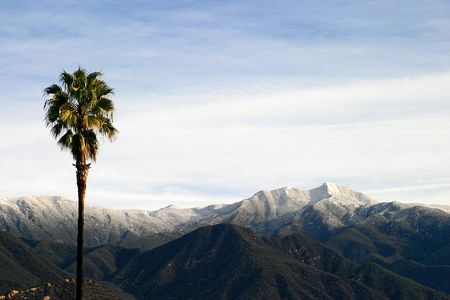 Landscape shot of the Ojai valley with snow on the mountains. photo