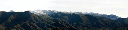 Landscape shot of the Ojai valley with snow on the mountains.