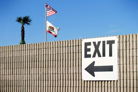california flag: exit sign with the usa and california flag and a palm tree Stock Photo