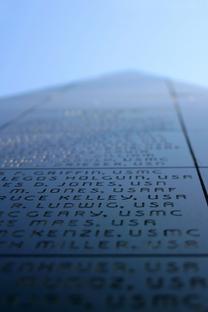 Black pyramid stone structure with names of the veterans photo