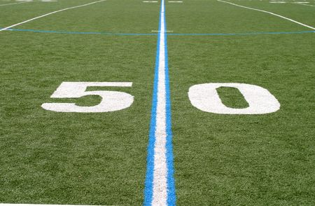 Green football field with large yard numbers.