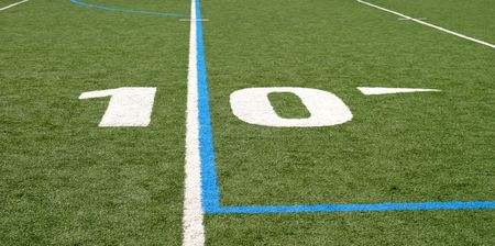 ten empty: Green football field with large yard numbers.