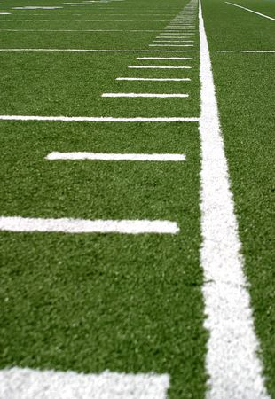 yardline: Green football field with large yard markers.