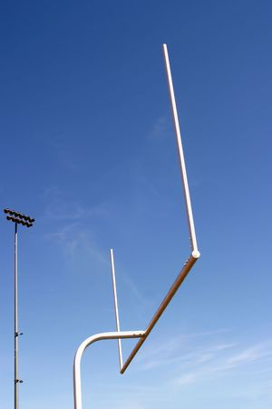 post: American football goal with the sky as a background.