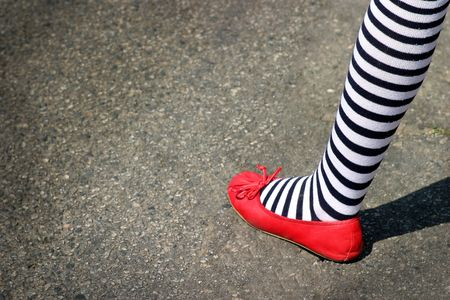 Pattic foot with red shoe and blue white striped sock. Stock Photo - 3466132